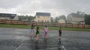 art room students in rain