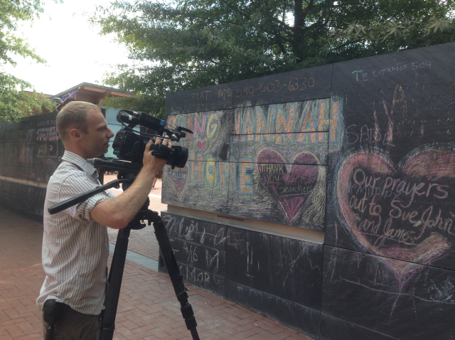 street portrait-5 - dc camera guy filiming hannah graham sign charlottesville va 2014 - priorhouse